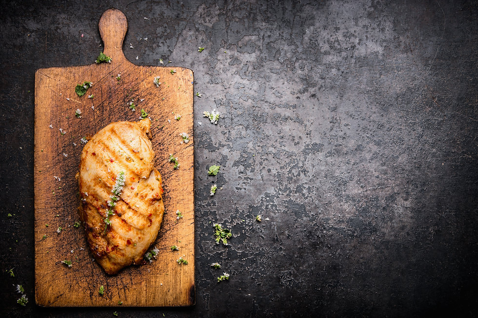 Roasted Chicken fillet on aged wooden cu