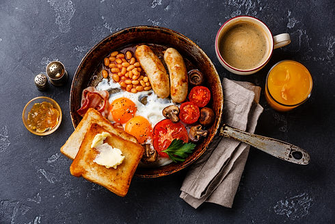 English breakfast in pan with fried eggs