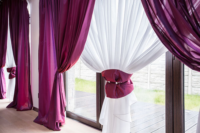 Elegant curtain and purple drapes in lux