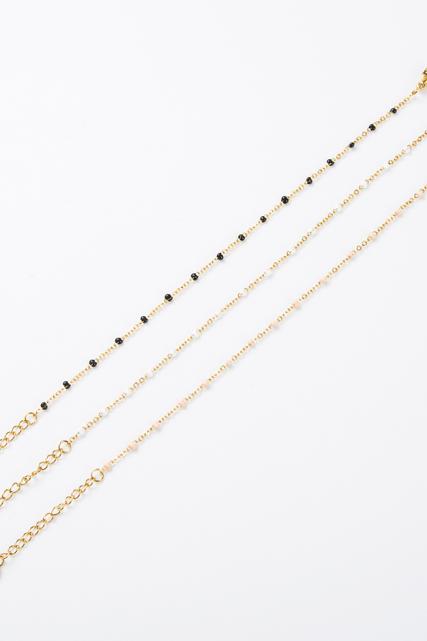 Bracelet fin perle noire et dorée