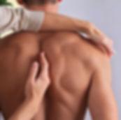 stock-photo-man-having-chiropractic-back