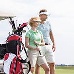 smiling-man-woman-standing-golf-course-a