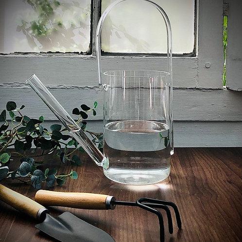 Regadera de vidrio