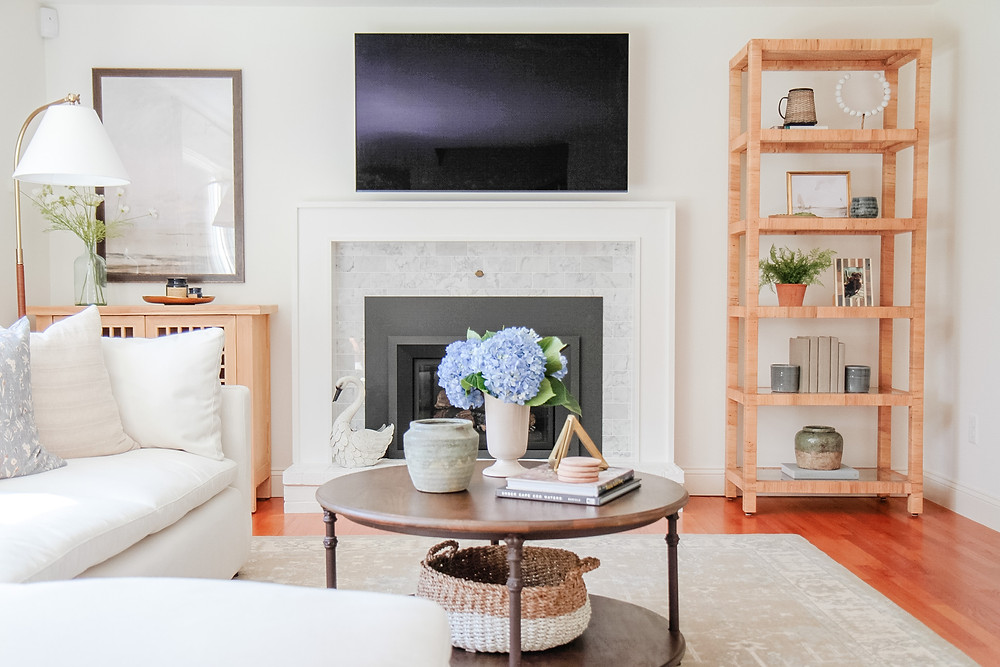 fireplace with tv above mantle, mismatched furniture flanking fireplace, benjamin moore simply white, living room
