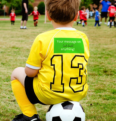 Child sitting on soccer ball wearing custom sport jumper