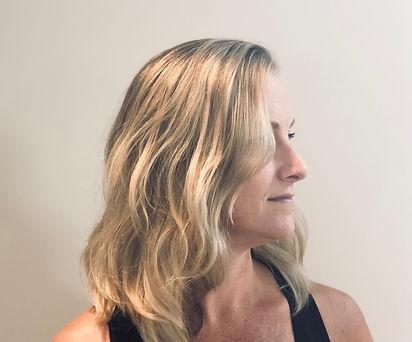 Side profile of wavy long blonde hair