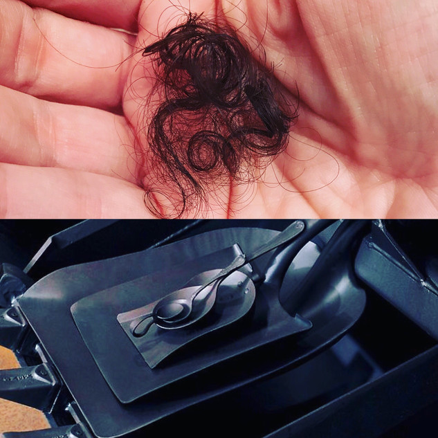 Top: The first lock cut from my son's hair. Bottom: Cradle, Janine Antoni.