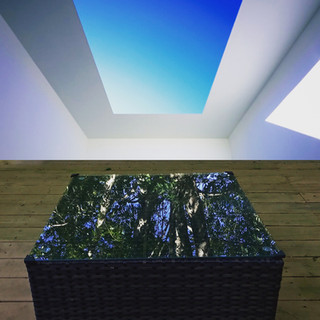 Top: Blue Planet Sky, James Turell. Right: Family afternoon on the deck with coffee table.