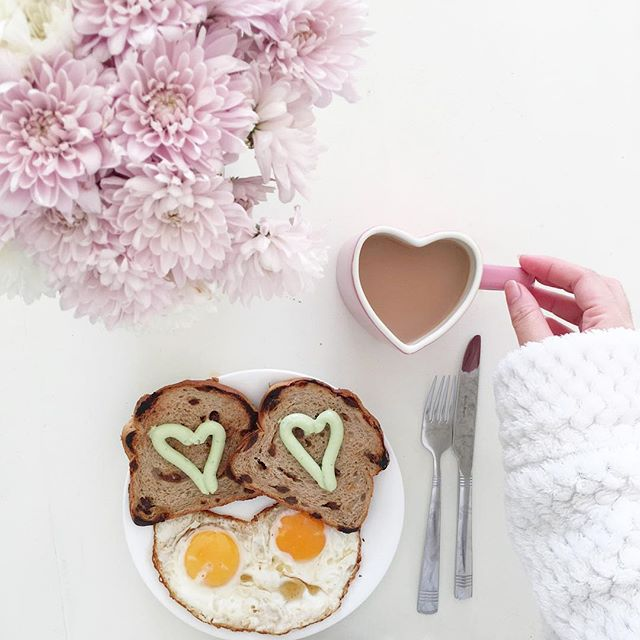 Cute breakfast and pretty flowers make t