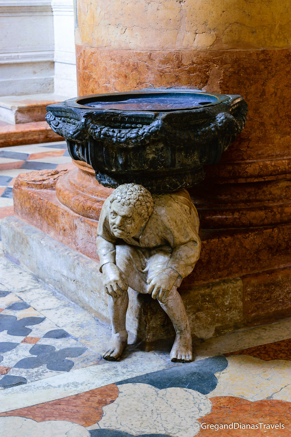 Hunchback at the entrance of Basilica of Sant´Anastasia