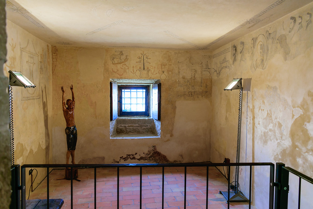 Wall paintings made by prisoners in Guaita Fortress
