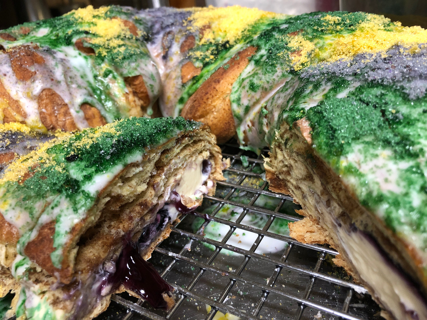 One of our delicious King Cakes oozing goodness!