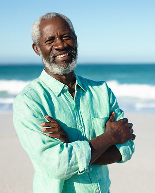 old-man-smiling-at-the-beach-ETU9JMG.jpg