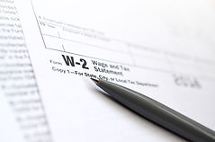 the-pen-lies-on-the-tax-form-w-2-wage-an
