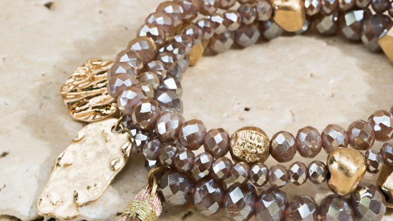 Shimmering faceted glass bead and nugget bead with hammered charm