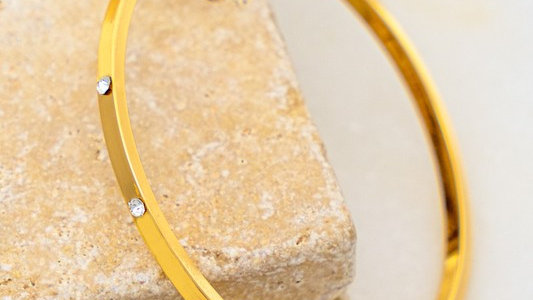 Josephine's gold bangle with rhinestones