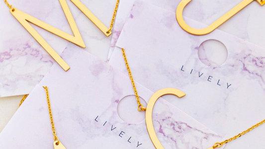 Josephine's block letter initial necklaces.