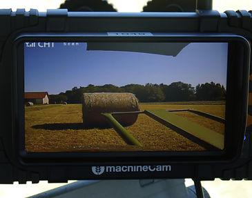 Ballenauswurf an Presse beobachten - per Kamera, denn im Spiegel keine Sicht