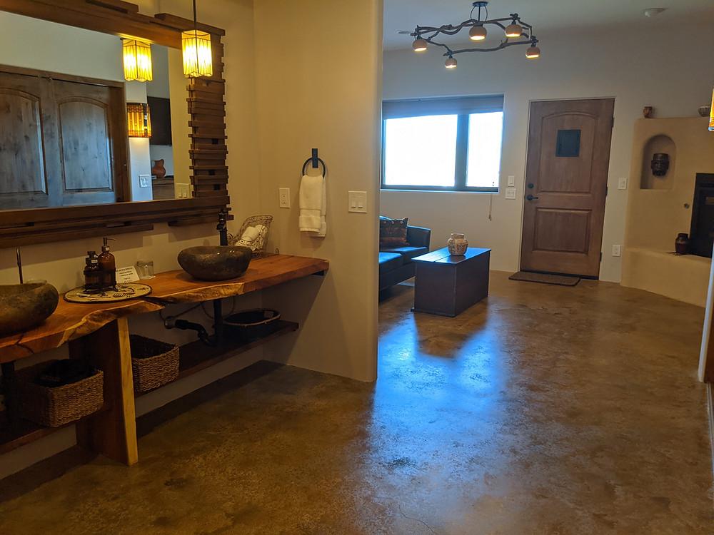 Pueblo Room, looking past the stone sink basins toward the patio door.
