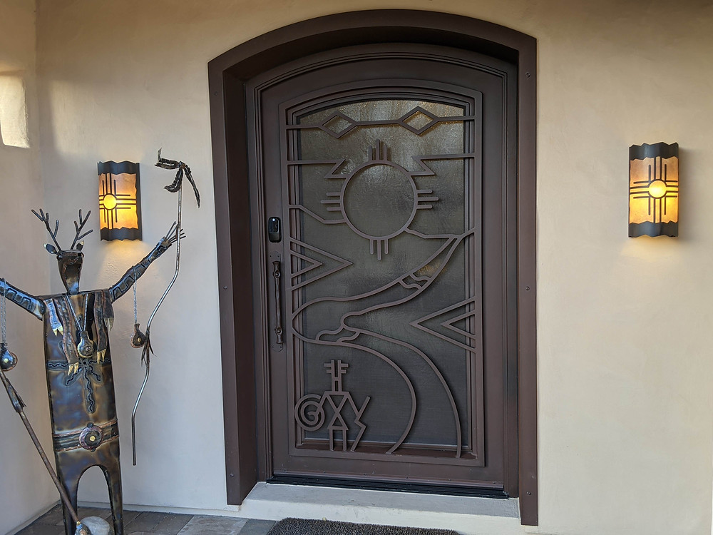 Close-up of the custom-designed iron front door