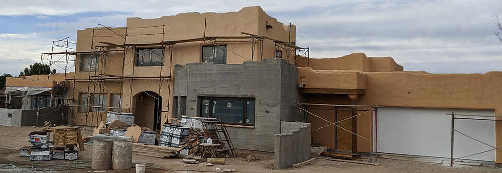 Exterior with scaffolding, getting its final paint (three hues of tan)