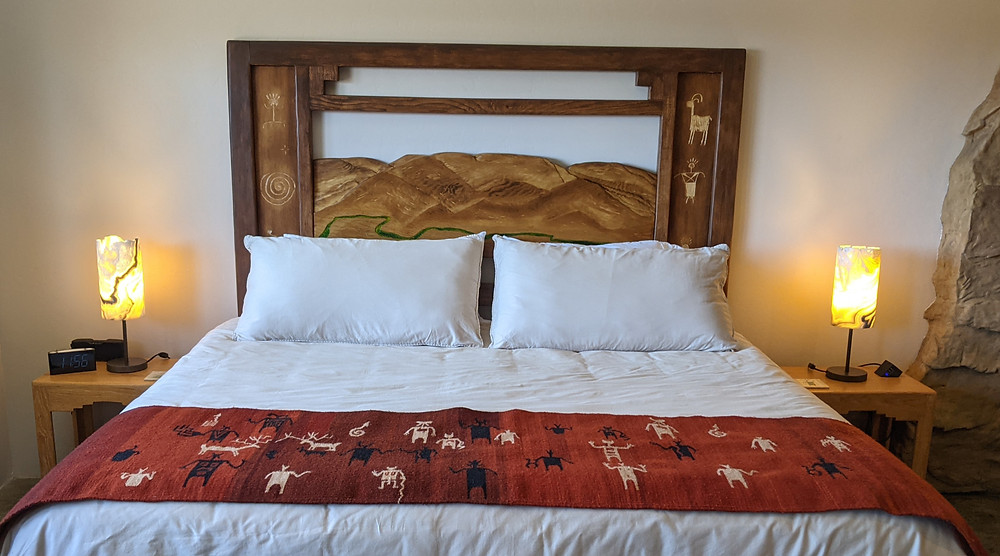 Wood=frame headboard, stained dark brown, with a panel that portrays Mingus Mountain.