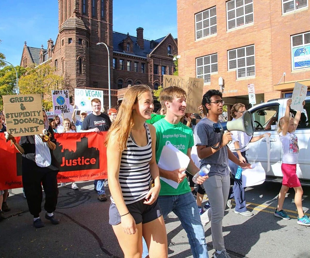 NY²CL co-founders Lindsay Cody, Liam Smith, and Hridesh Singh (from left to right) march in the Rochester Climate Strike on September 27th, 2019.