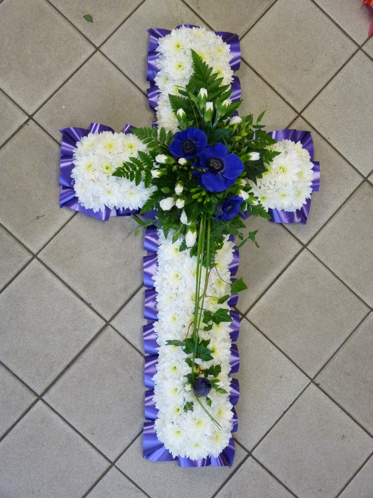 blue and white cross funeral tribute.jpg