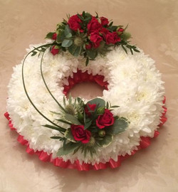 white bases wreath ring and red roses fu