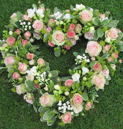 pink and white funeral heart.jpg