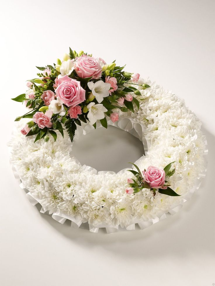 white bases wreath ring funeral tribute.