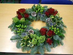 xmas wreath in reds and greens.jpg