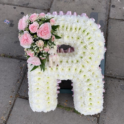 white based letter funeral tribute.jpg