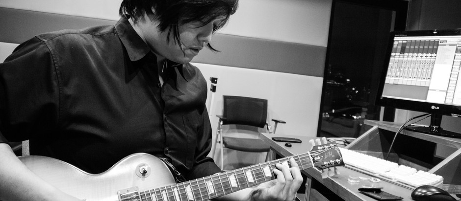 Guitar Rehearsing Before Recording