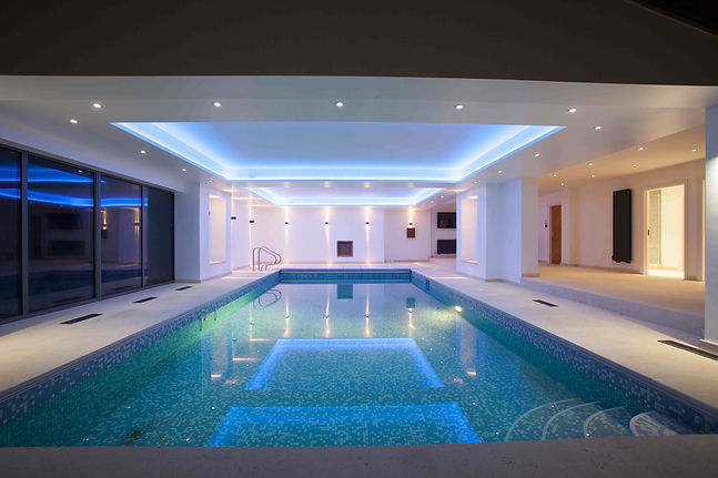 Swimming pool interior with LED lighting & stretch ceiling