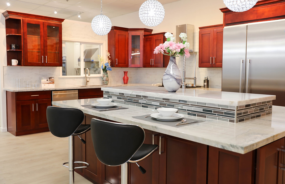 This kitchen is an example of using a darker shade on the lower cabinets and a lighter shade on top.