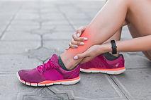 female-athlete-having-ankle-injury-sitti
