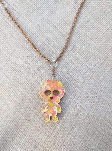 Pendentif squelette rose