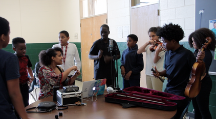 Students bringing their best to the table to make song about togetherness