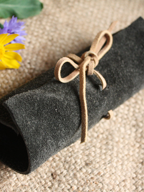 Upcycled leather pencil wrap