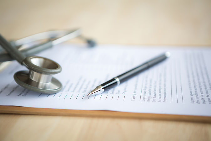 stock photo of stethoscope, pen and paperwork
