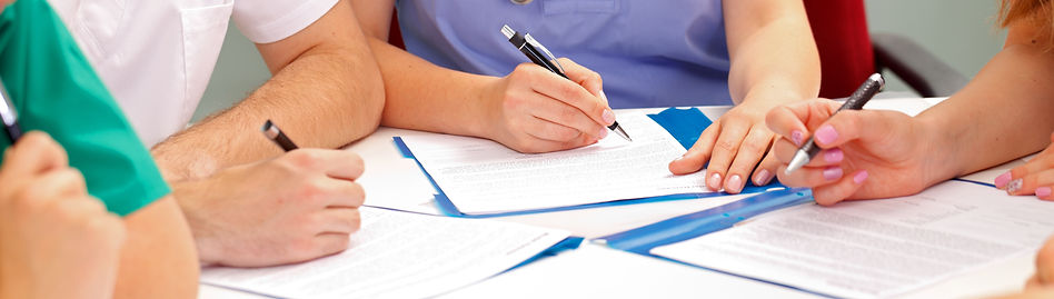 stock photo of group filling out paperwork