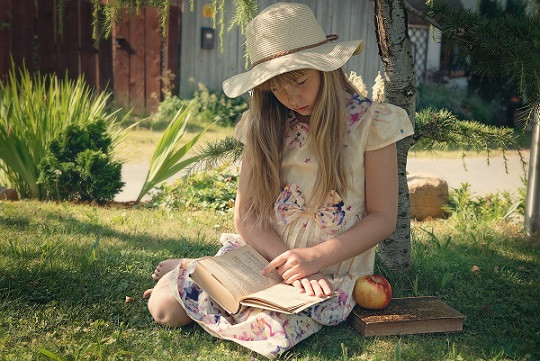 Student reading fiction book in summer