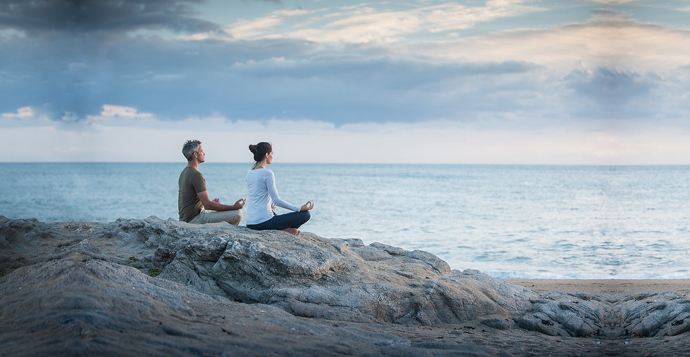Couple meditate beach wide.jpg