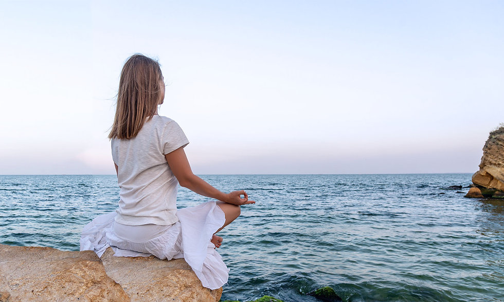 Woman meditate ocean-wide.jpg