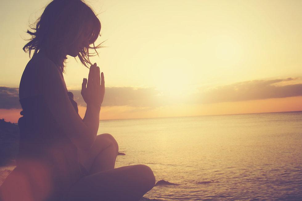woman meditate ocean.jpeg