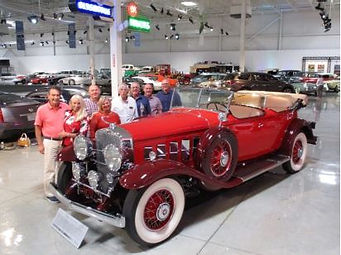 members touring gm heritage site.JPG
