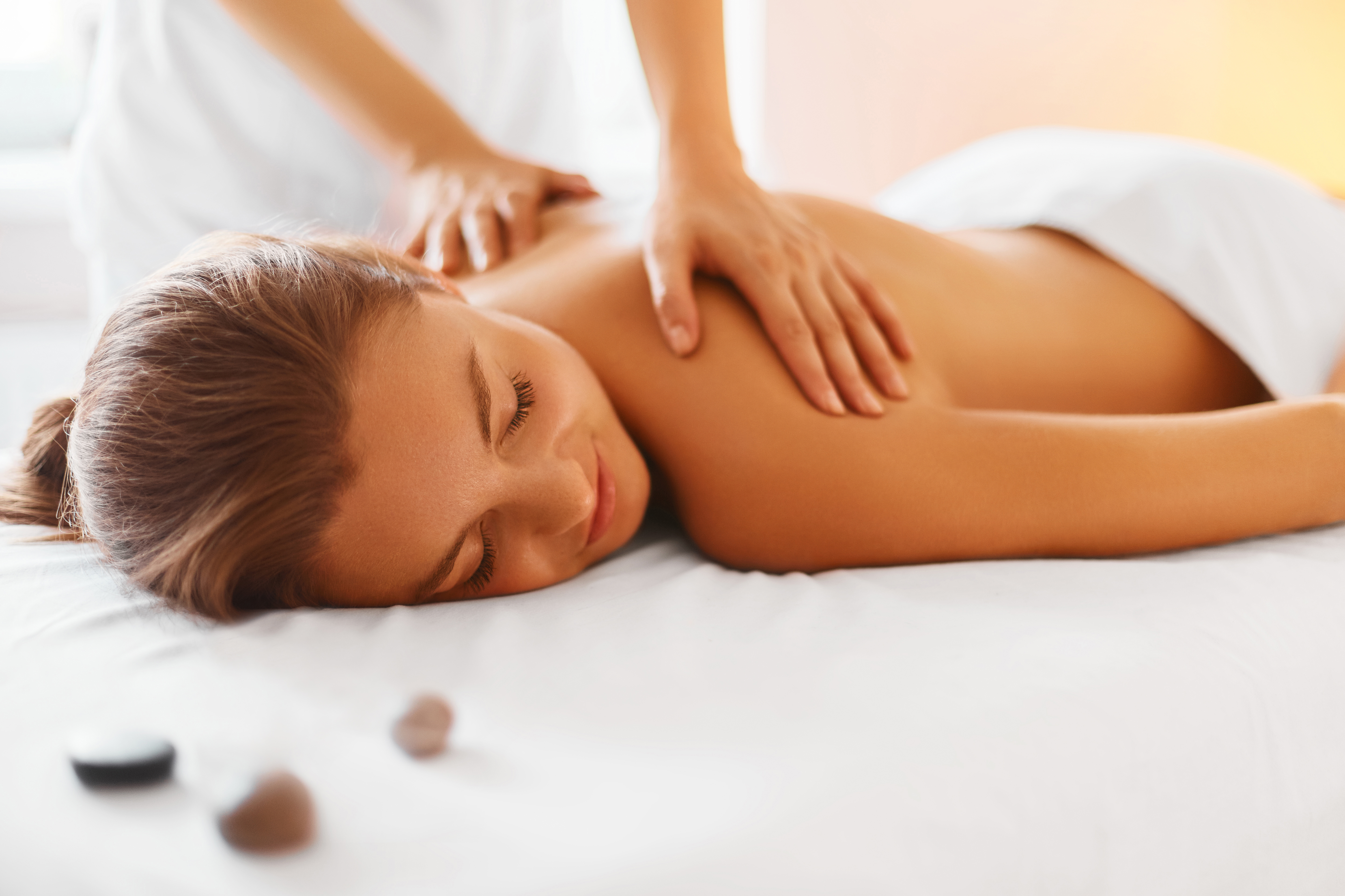 Spa woman. Female enjoying relaxing back