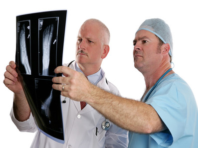 dr looking at x rays.jpg