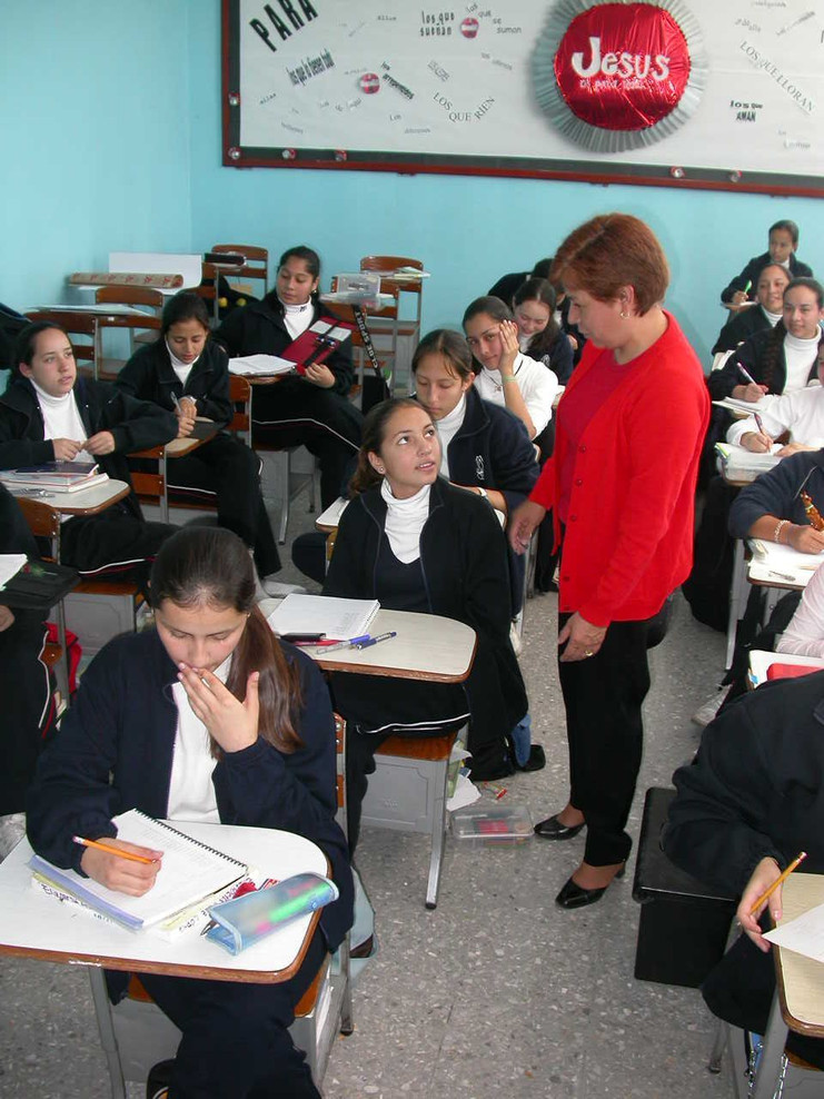 Lay faculty member in the classroom in a school in Mexico.